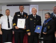 At centre, Goderich Fire Cpt. John Dobie receives Firefighter of the Year for 2011.