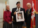 Richard Robarts and his wife, Donalda, of Goderich and Windsor, present Paul Thorne, who is president of Royal Canadian Legion Branch 109, with a lithograph portrait of Queen Elizabeth II on the occasion of Her Majesty's Diamond Jubilee. Richard was a recent recipient of the Queen' s Diamond Jubilee Medal and was given the print to mark the occasion.