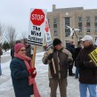 Anti-wind turbine supporters rally outside Goderich's courthouse.