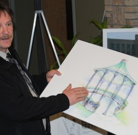 John Grace, the deputy reeve of Goderich, explains the gazebo designed for the town's downtown park during a public meeting recently.